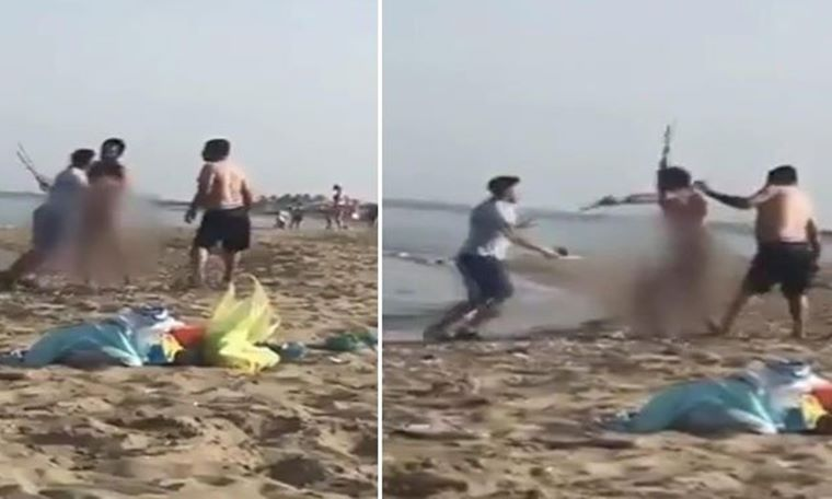 Plajda çıplak gezen adama meydan dayağı
